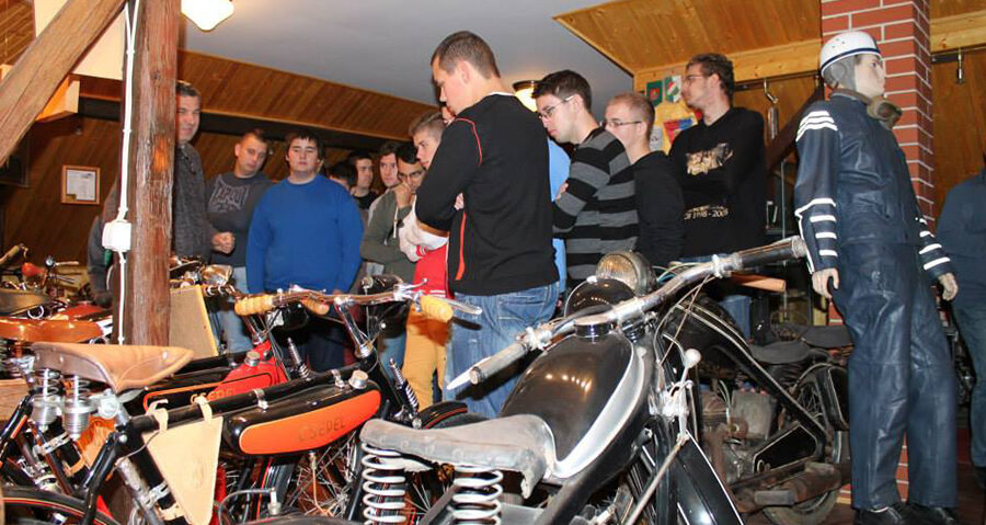 Car mechanic students around the motorcycles!